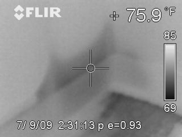 Thermal images of wet wall behind baseboard
