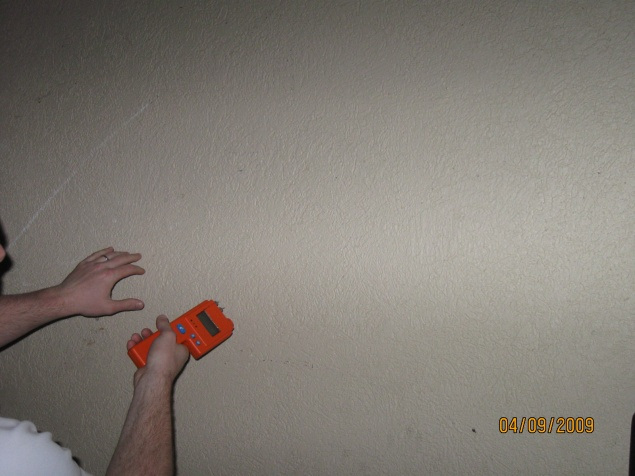 Use of moisture meter to determine the level of moisture in drywall